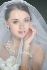 A beautiful young girl is in a wedding decoration